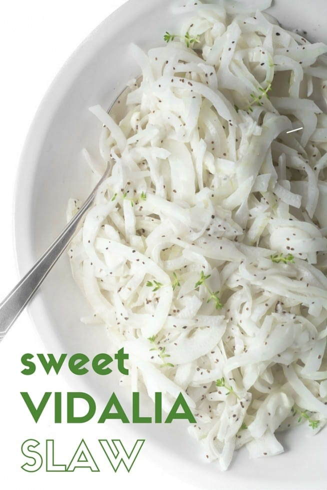 Sweet Vidalia Onion Slaw is an utterly simple, utterly brilliant side for your next picnic, barbecue, or potluck --- the famously mellow onions are sliced paper thin and tossed with a cool buttermilk dressing --- it's a little bit of heaven on a paper plate! #vidaliaonions #onionslaw #slaw #barbeque #picnic #salad #picnicsalad #summersalad #buttermilkdressing