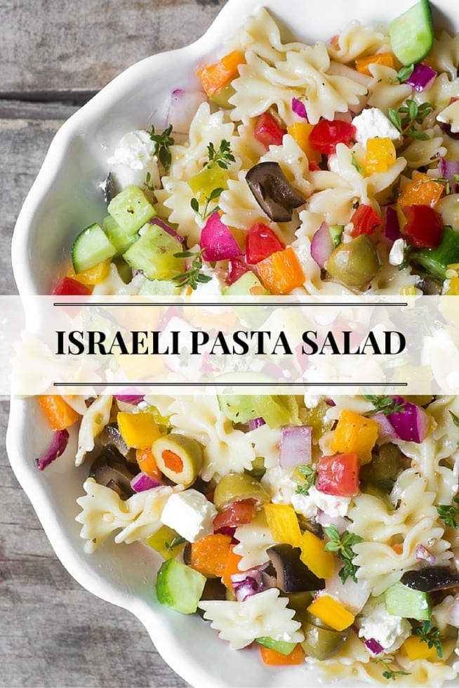 Israeli Pasta Salad is a mash-up of two of my favorite summer salads, it's packed with veggies and is the perfect make-ahead potluck  or bbq dish-- it actually gets better after a day or two in the fridge! #pastasalad #vegegarian #israelisalad #potlucksalad #barbequesalad #picnicsalad #potluck #pastasaladrecipe #summersalad #easypastasalad