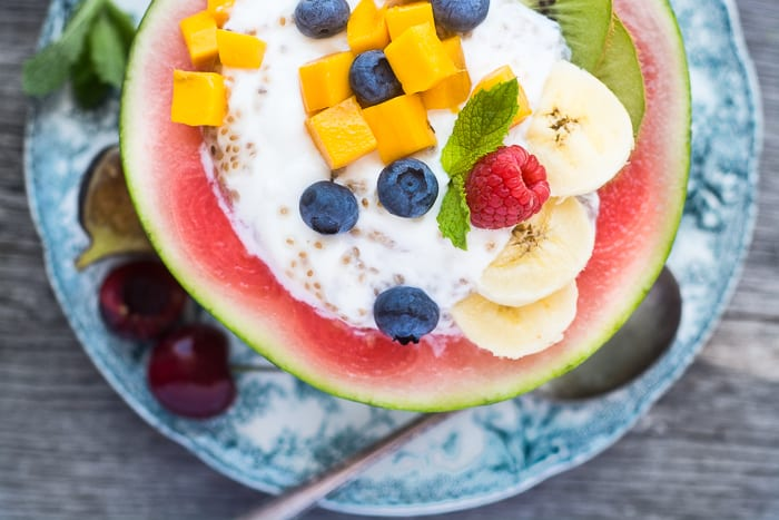 Melon Breakfast Bowls filled with chia seed yogurt and fresh fruit will get any day off to a great start!   theviewfromgreatisland.com