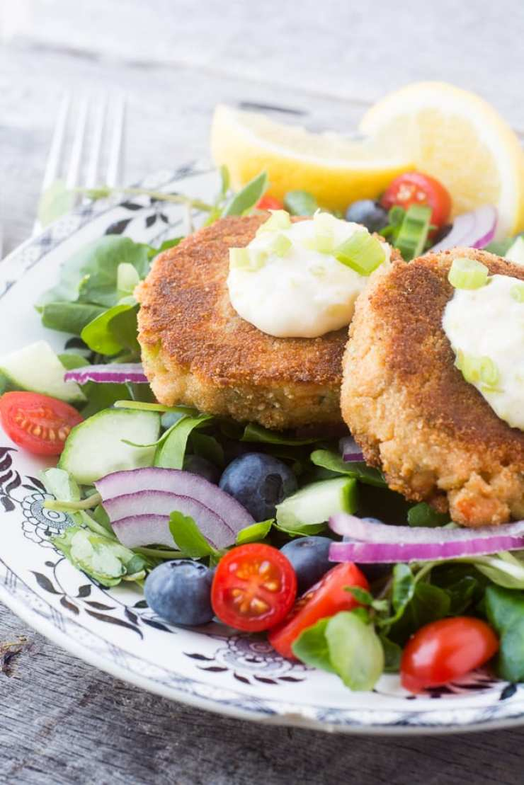 Salmon and Zucchini burgers are tender and delicious atop a fresh watercress salad ~ theviewfromgreatisland.com