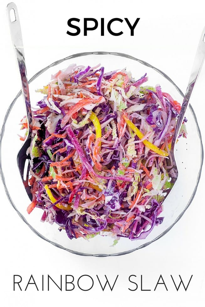 This healthy Spicy Rainbow Slaw with a tangy lemon yogurt dressing is made with red and green cabbage, bell peppers, watermelon radishes, jicama, and a touch of jalapeno complements any summer meal --- it's cooling, crunchy, and crazy colorful! #salad #coleslaw #rainbow #healthy #summerside #barbecueside #picnicside #4thofJulyrecipe #memorialdayrecipe #grilling #cabbage #peppers #jicama #jalapeno #watermelonradish