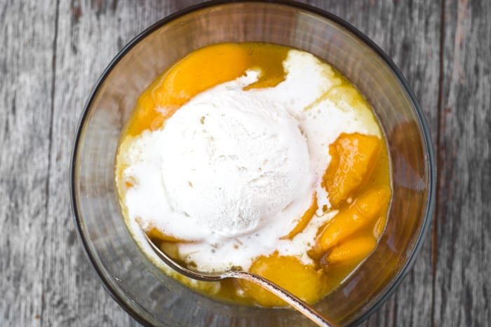 Fresh and juicy Bourbon Fried Peaches with Ice Cream is the most luxurious fruit dessert out there! | theviewfromgreatisland.com