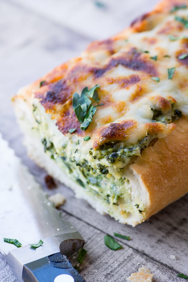 Cheesy Spinach Artichoke Bread is a fabulous game night appetizer, you can dispense with the chips, the dip is right in the bread! | theviewfromgreatisland.com