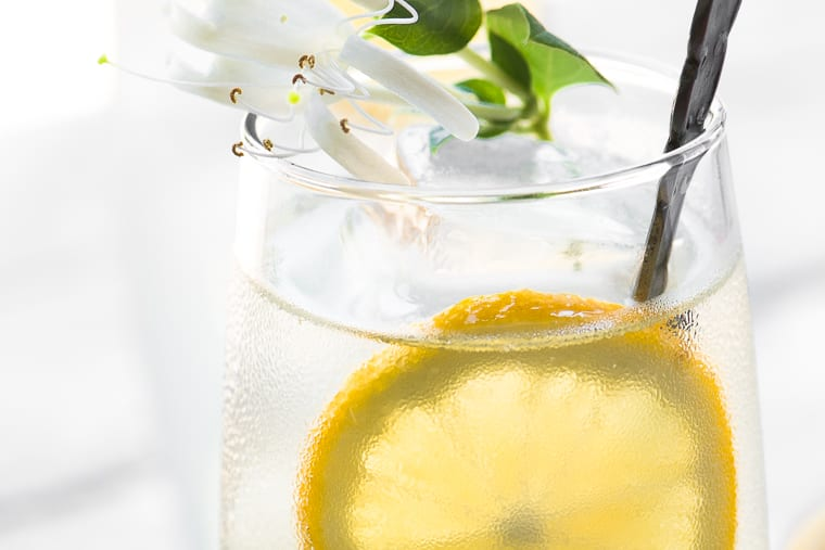 Honeysuckle Vodka Lemonade ~ this uniquely refreshing spring cocktail is made with homemade honeysuckle infused vodka and fresh squeezed lemonade...  vodka   summer cocktail   infused alcohol   edible flowers   Mother's Day   spring cocktail   vodka  
