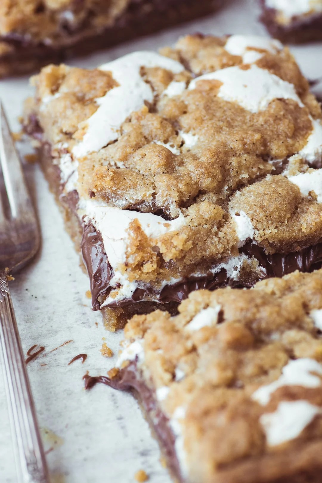Nutella S'mores Bars ~ everybody's favorite summer treat in an ooey, gooey, decadent, and delicious bar, no campfire needed! Make a batch and watch them disappear before your eyes.