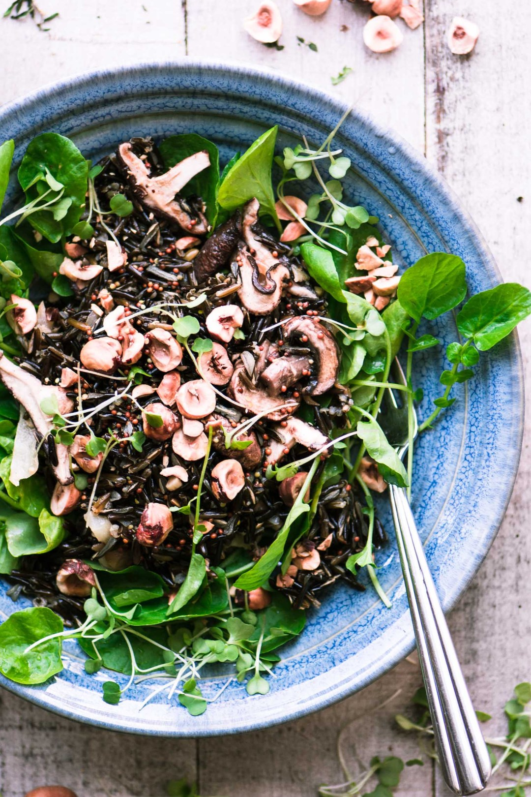 Wild rice salad with watercress in a blue bowl