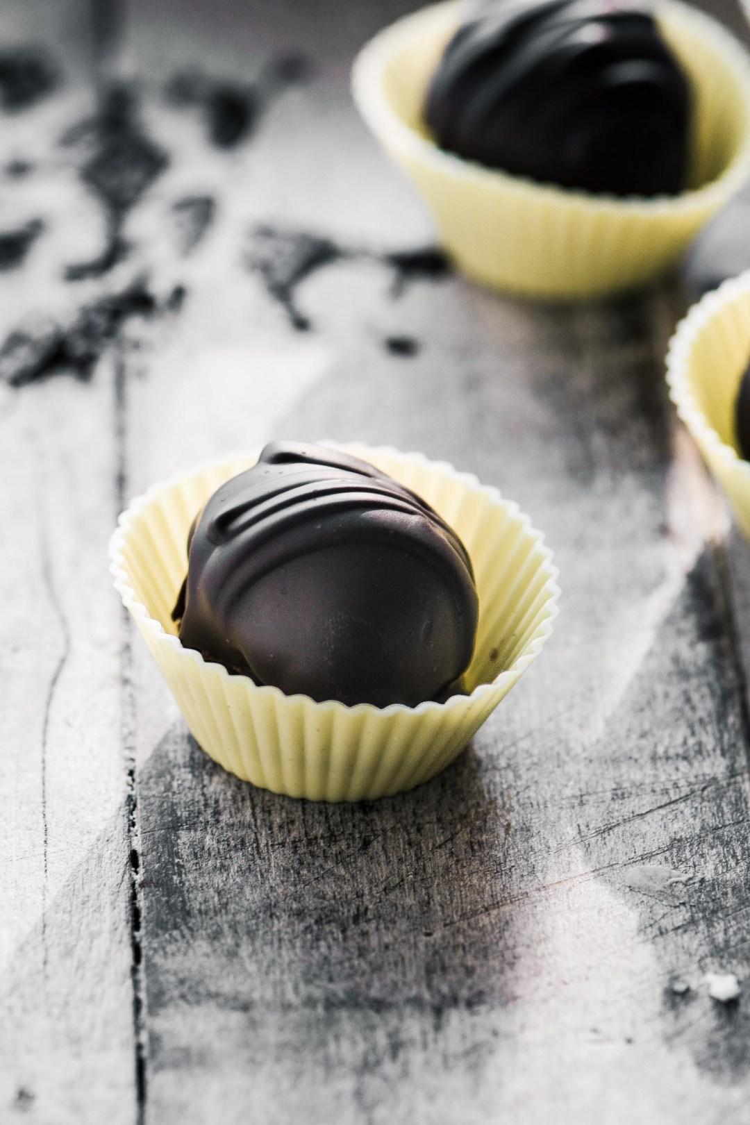 Fresh lemon truffles coated in dark chocolate imagery