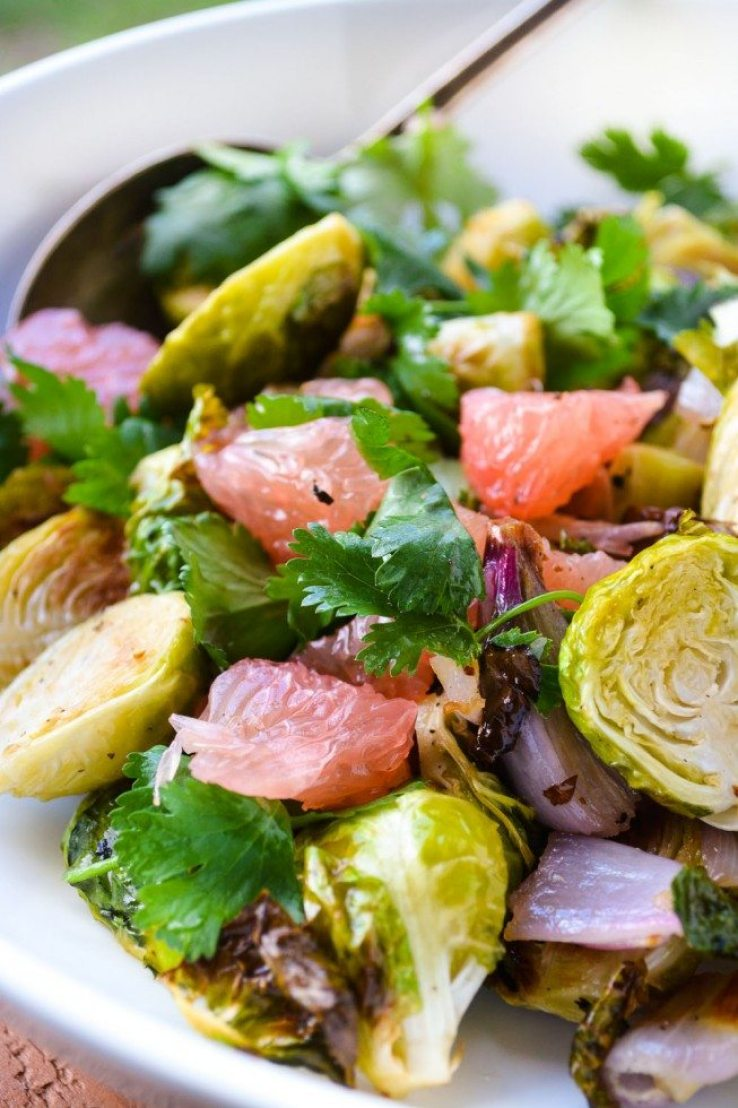Roasted Brussels Sprout and Pomelo Salad in a white bowl