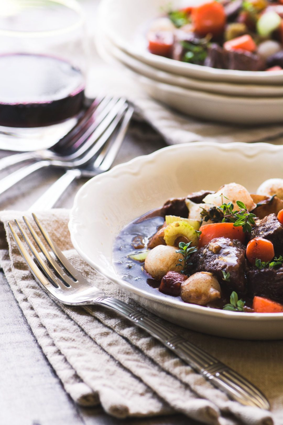 Instant Pot Beef Bourguignon in white bowls