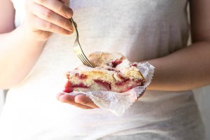 Girl holding a slice of Strawberry Buttermilk Cake
