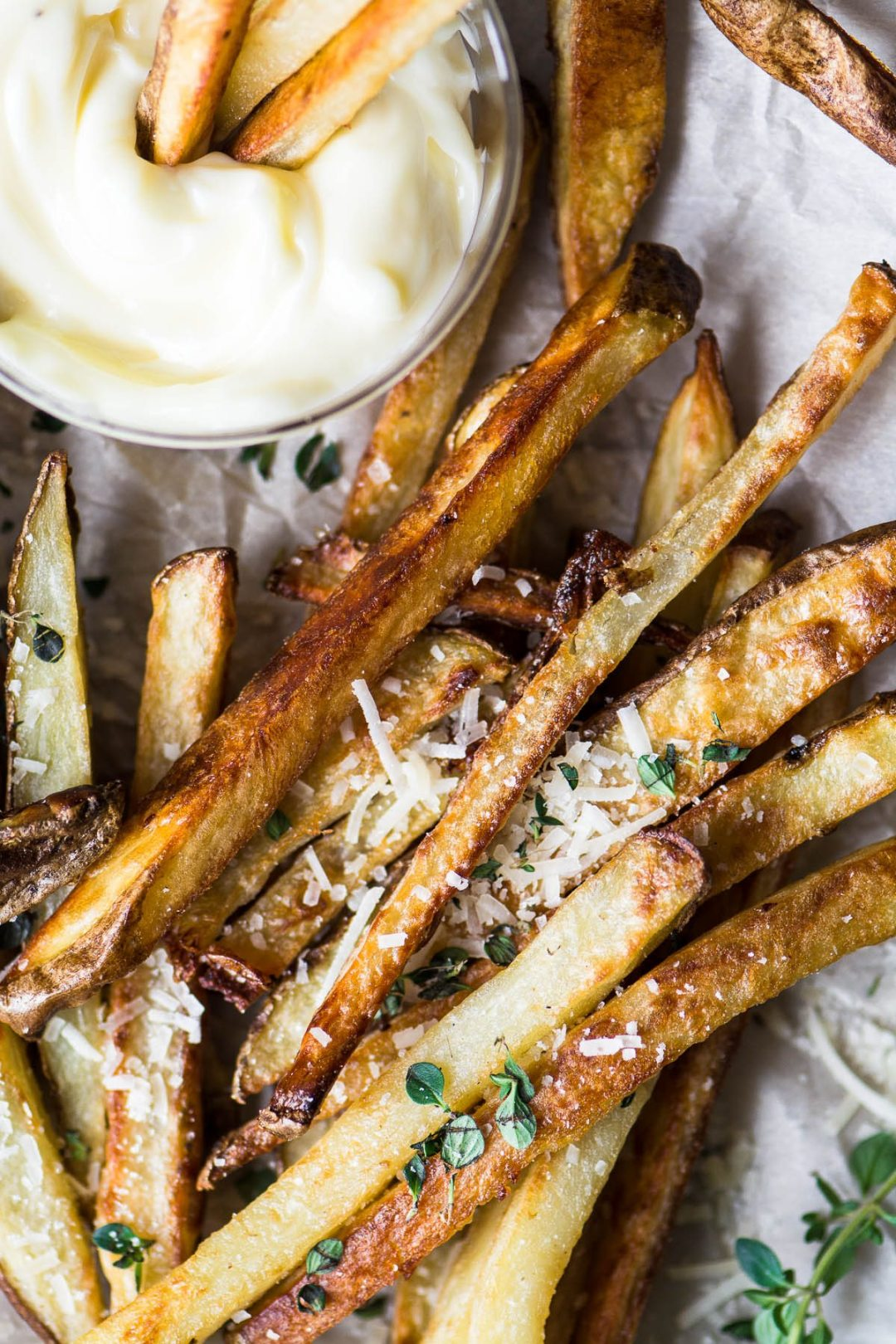 truffle fries with mayo dip on parchment paper