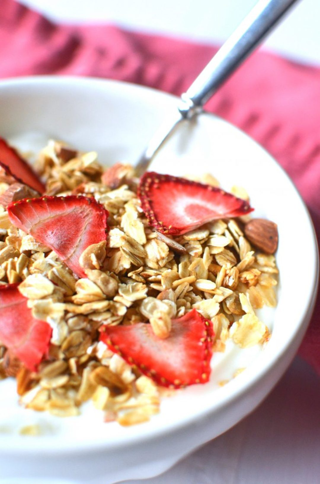 a bowl of granola with dehydrated strawberries