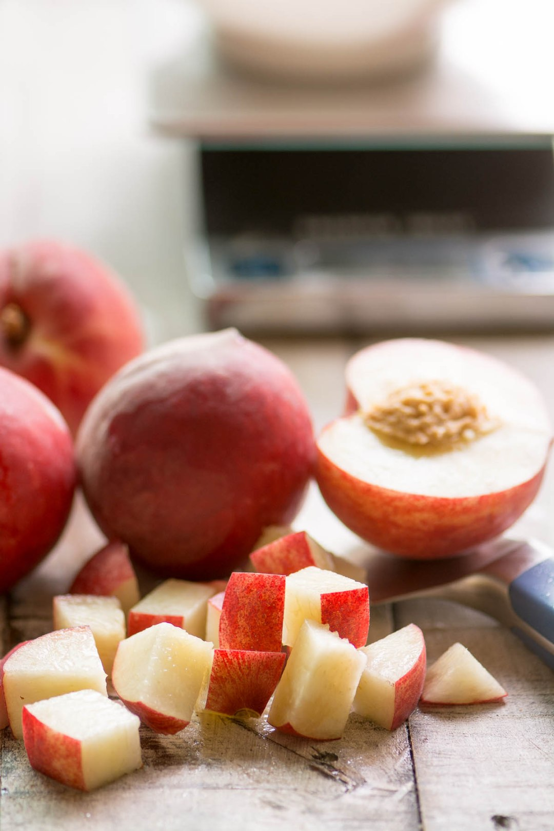 Chopping white peaches for peaches and cream breakfast cake