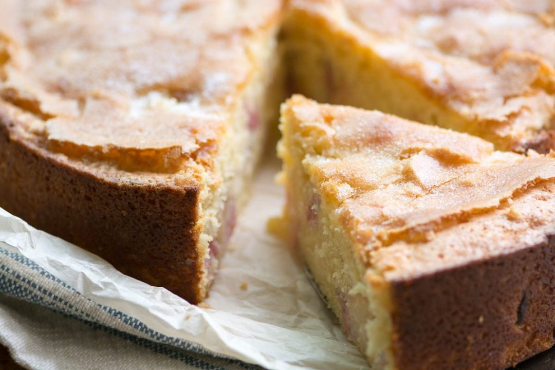 Peaches and Cream Breakfast Cake with a slice taken