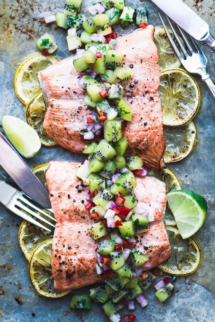 Roasted Salmon with Kiwi Salsa on a sheet pan with forks and knives