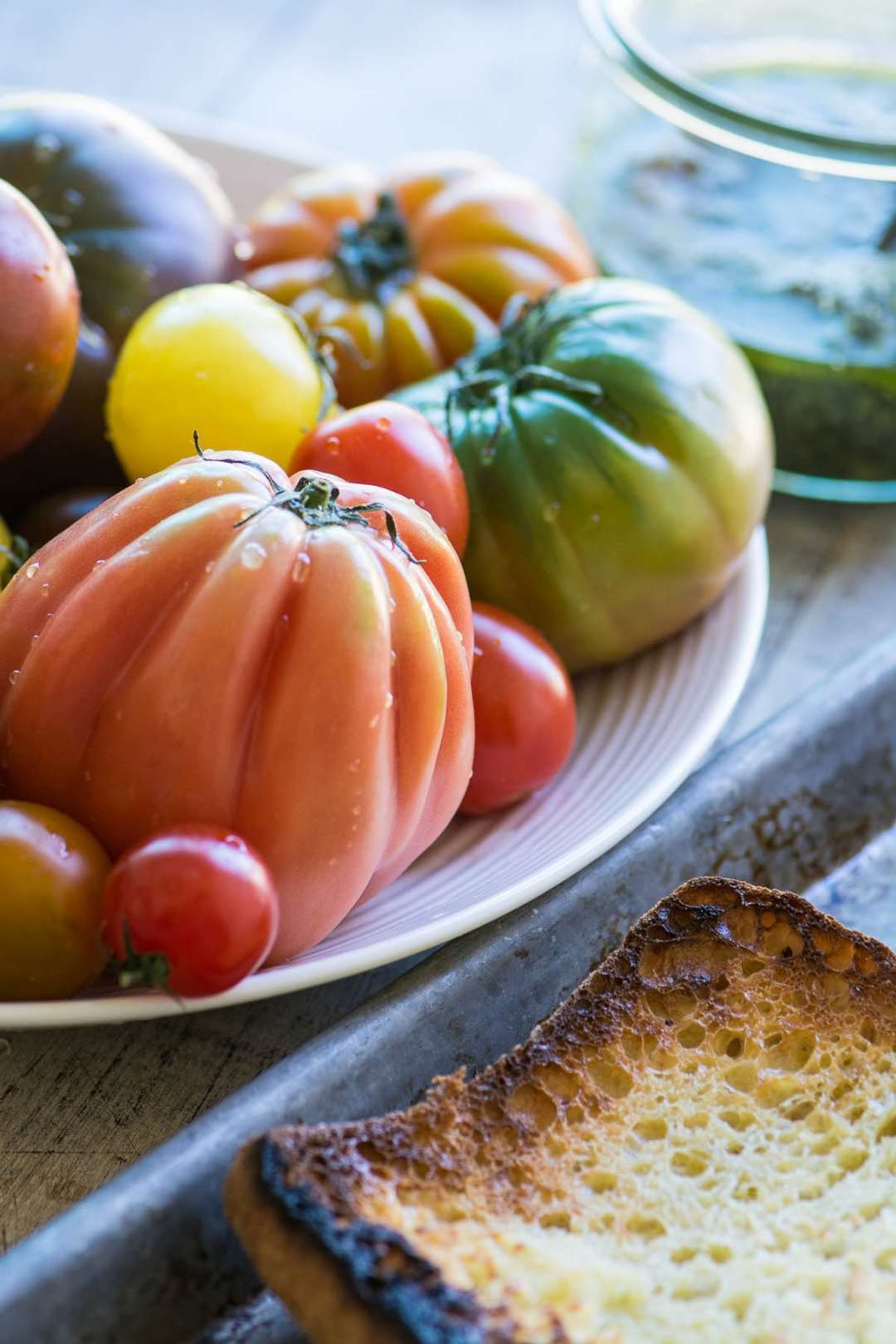 colorful heirloom tomatoes waiting to be sliced for Tomato Toast