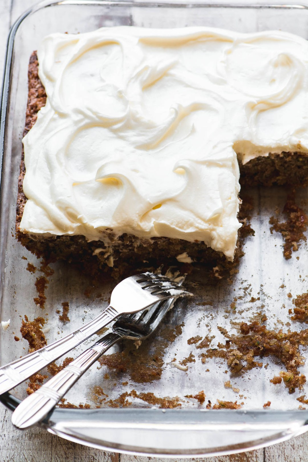 A pan of old fashioned zucchini cake with cream cheese frosting
