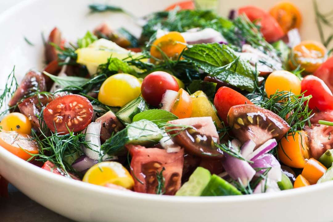 a bowl of colorful shirazi salad