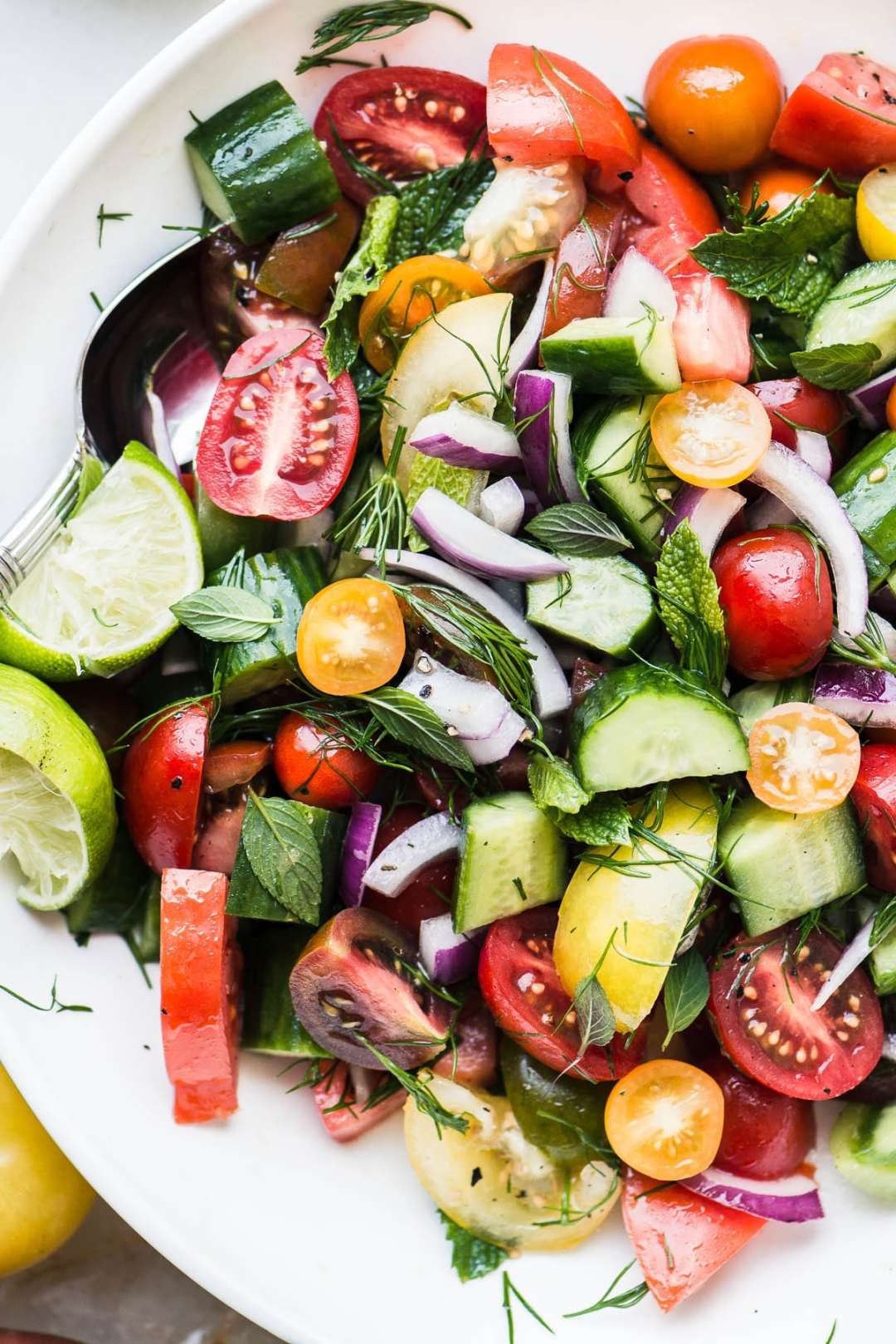 Colorful Shirazi Salad made with tomatoes, cucumbers, red onion, and herbs