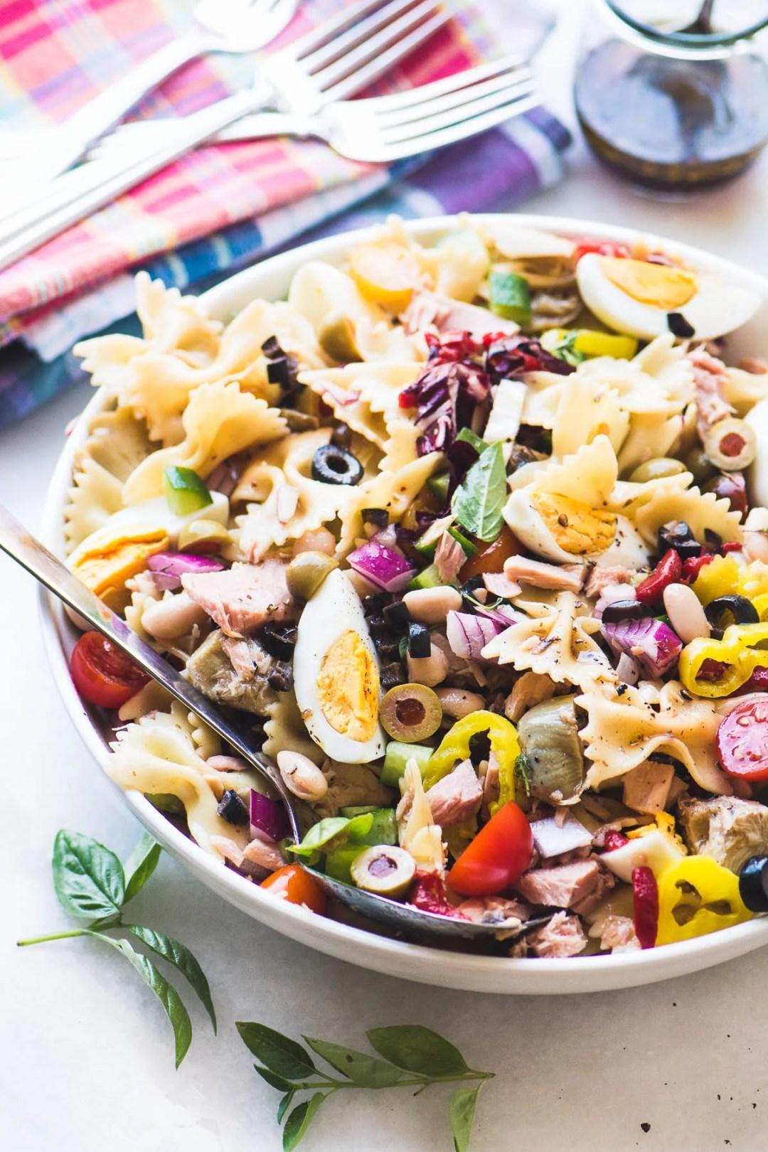 Mediterranean Pasta Salad with Tuna in a large serving bowl