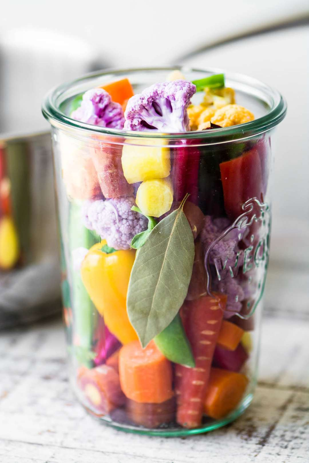 a large jar of quick rainbow giardiniera pickled vegetables