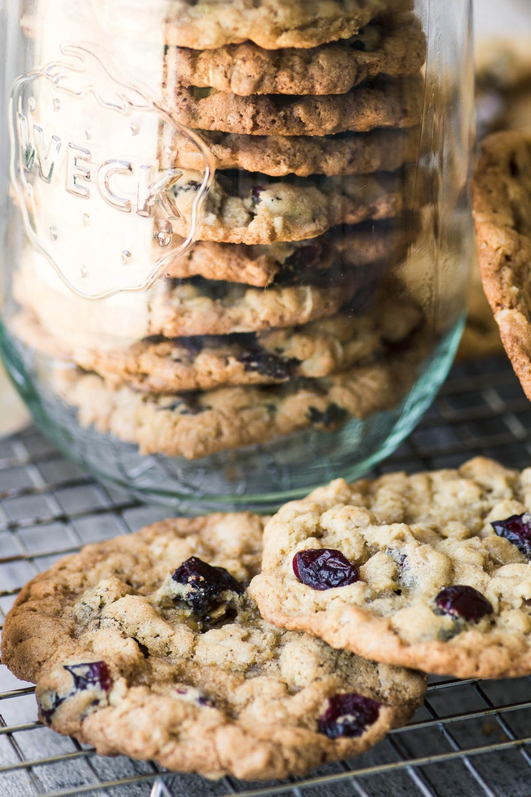 Old fashioned oatmeal cranberry cookies on a cooling rack