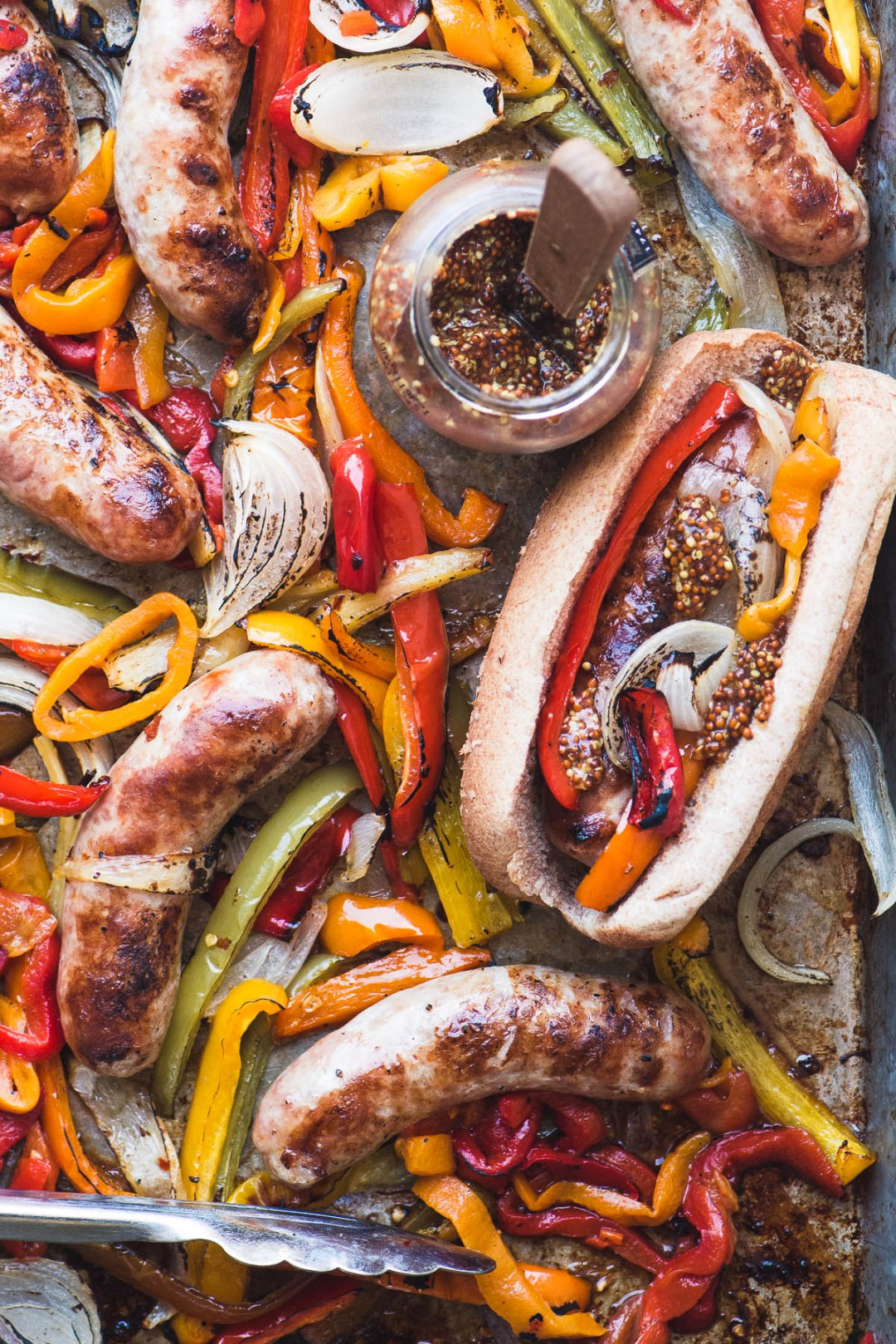 Sheet pan peppers and brats with grainy mustard