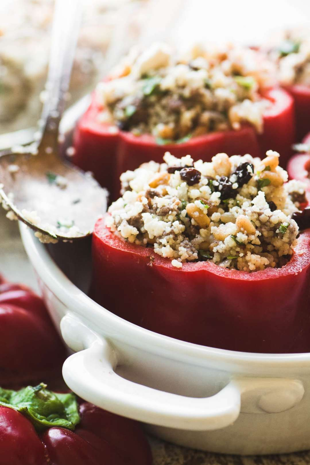 Spiced lamb and couscous stuffed peppers ready to bake