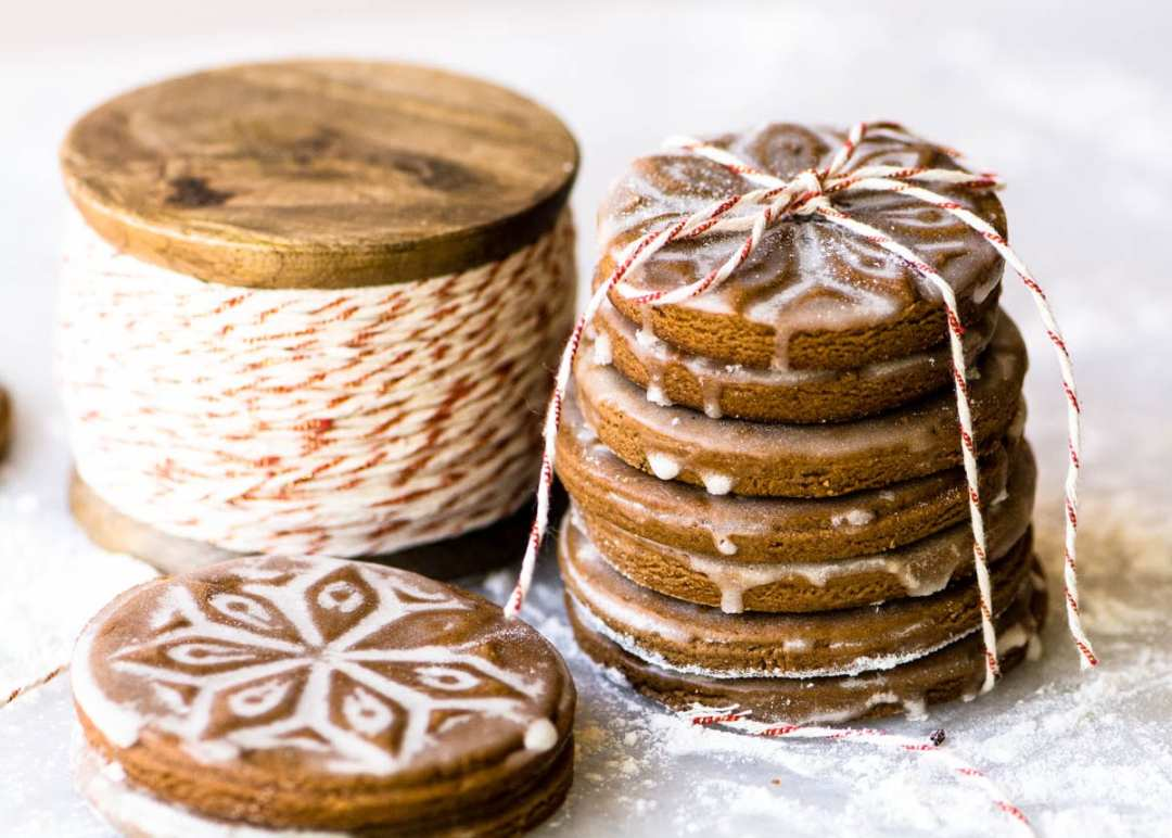 A stack of soft glazed gingerbread cookies tied up with twine