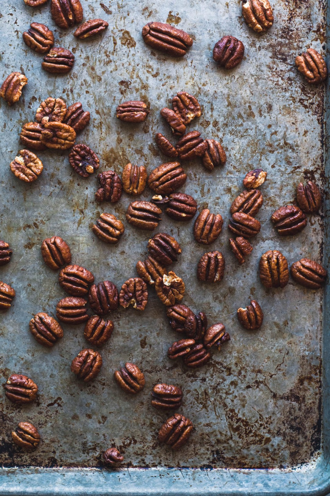 Roasting Maple Spiced Pecans on a baking sheet