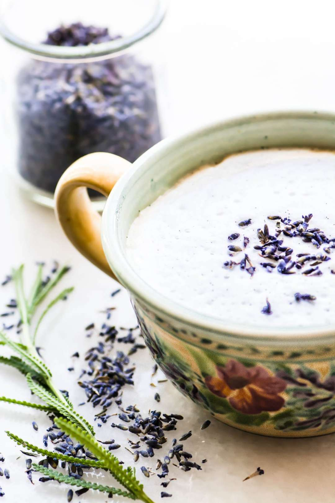 Vanilla lavender latte with fresh lavender sprig