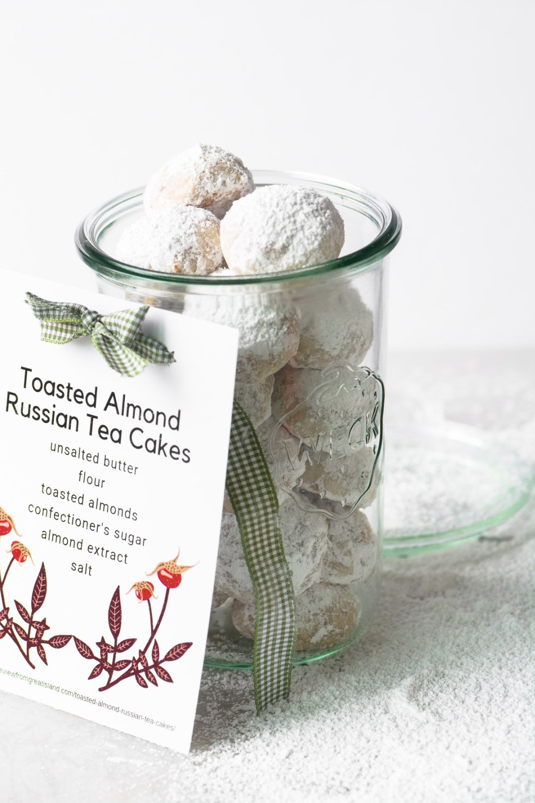 Toasted Almond Russian Tea Cakes in a mason jar with gift tag