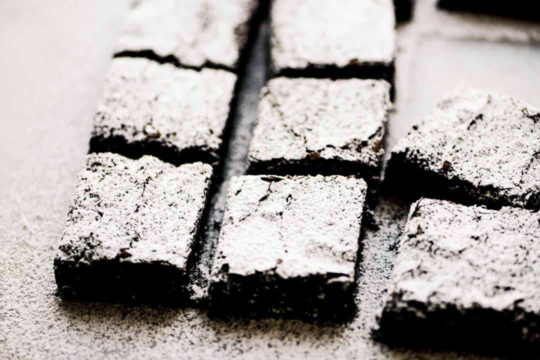 Will You Marry Me Brownies, sliced with powdered sugar