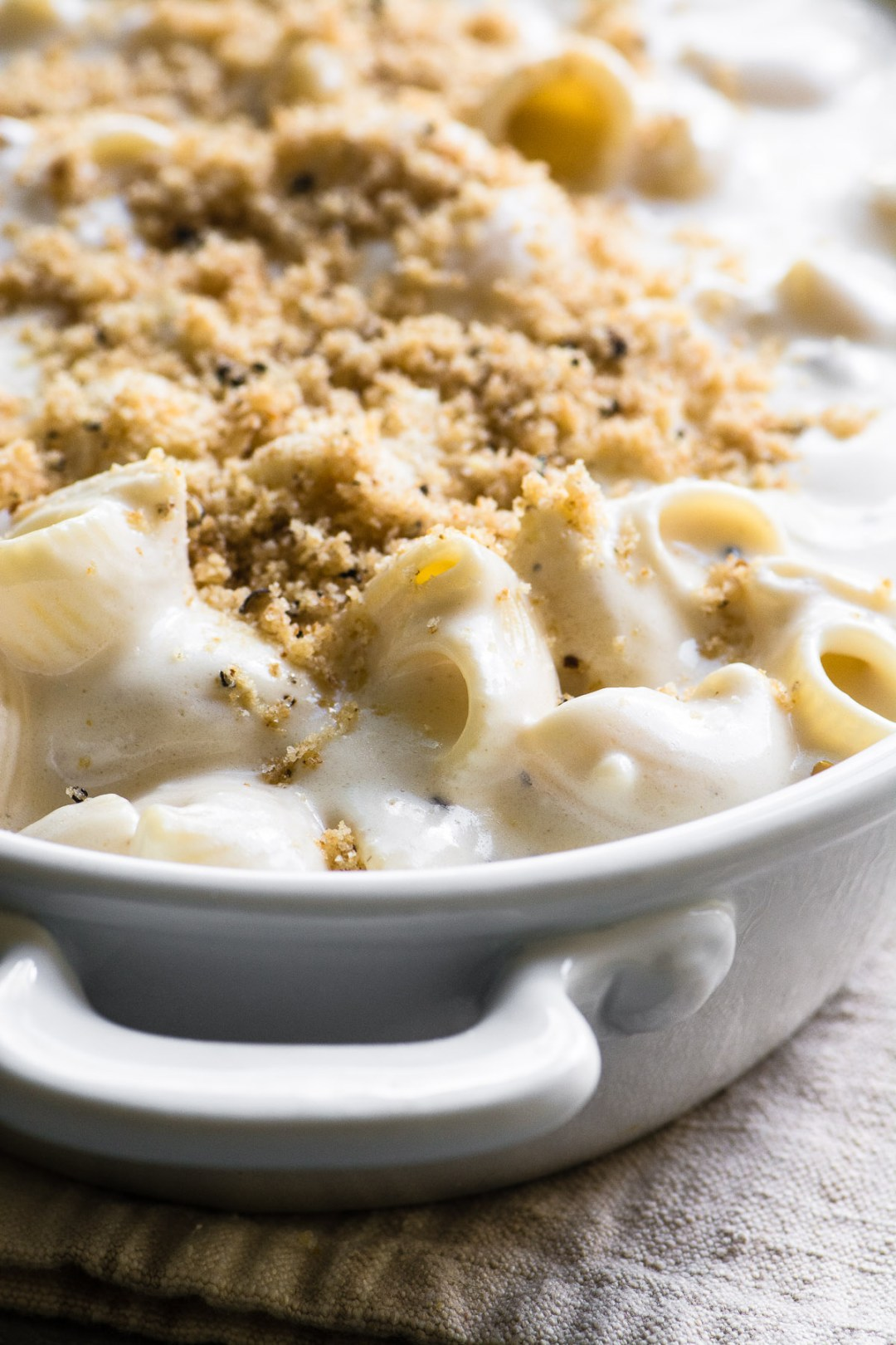 Truffle Mac and Cheese topped with breadcrumbs and ready to bake