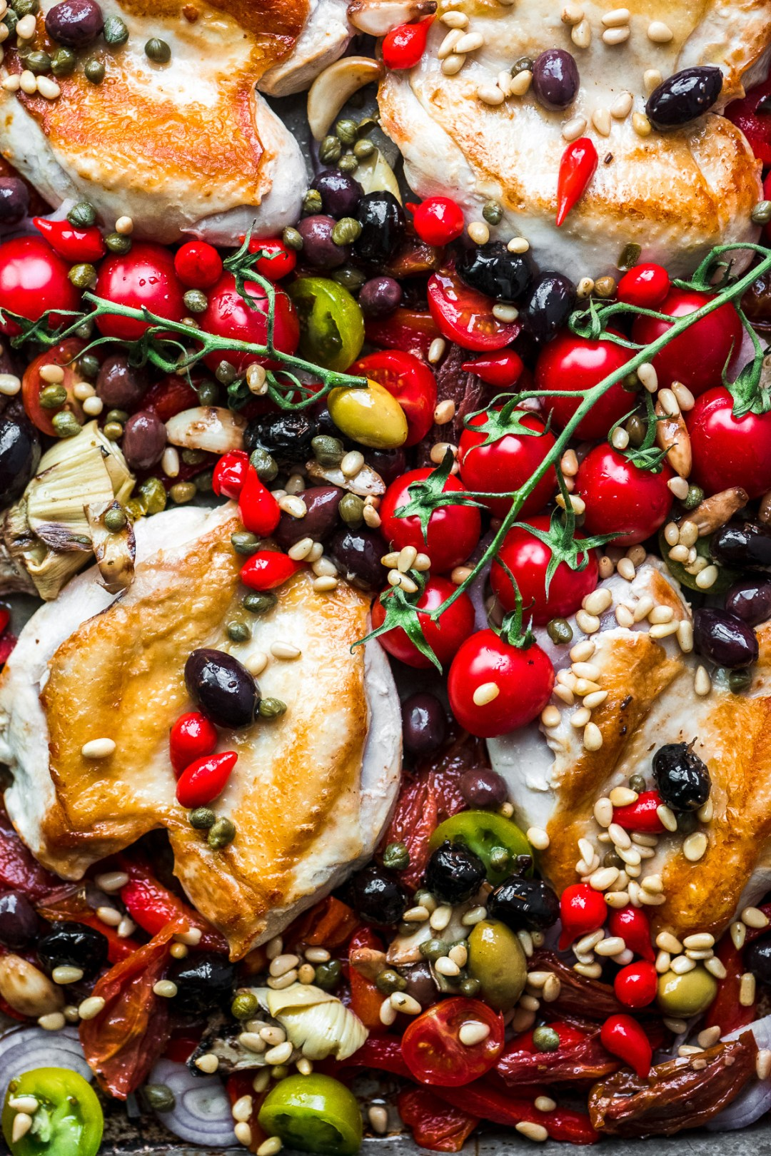 sheet pan chicken puttanesca with tomatoes on the vine 2
