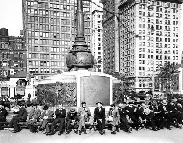 In October 1934, men — hopefully with jobs — relaxed on benches around Union Square's Independence Flagpole.