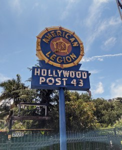a standing, neon sign that says American Legion Hollywood Post 43