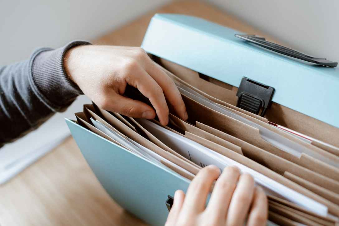 person choosing document in folder