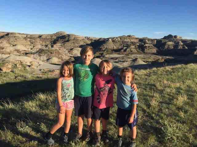 crazy family adventure children standing in the desert