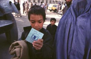Kabul, Afghanistan -- Food ration cards are handed out prior to the WFP food distribution at the old Soviet compund in Kabul. 12/20/01 (Photo by Bikem Ekberzade)