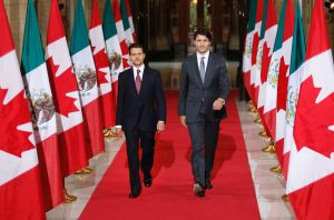 "Mexican President Enrique Pena Nieto(L) and Canadian Prime Minister Justin Trudeau walk out to speak with the media following bilateral meetings ahead of the ""Three Amigos Summit"" at Parliament Hill in Ottawa, June 28, 2016. Canadian Prime Minister Justin Trudeau and his guests US President Barack Obama and Mexican President Enrique Pena Nieto will meet in Ottawa for the North American Leaders Summit June 29 morning under a climate of economic uncertainty following Britain's vote to leave the European Union. / AFP PHOTO / Chris RoussakisCHRIS ROUSSAKIS/AFP/Getty Images ** OUTS - ELSENT, FPG, CM - OUTS * NM, PH, VA if sourced by CT, LA or MoD **"
