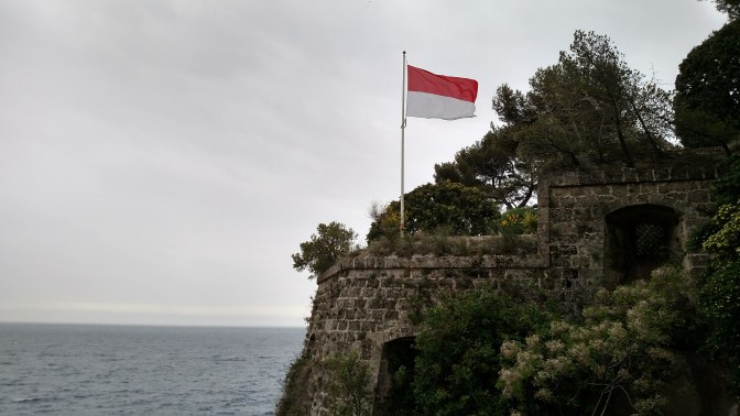 fort with flag of Monaco (an independent city-state)