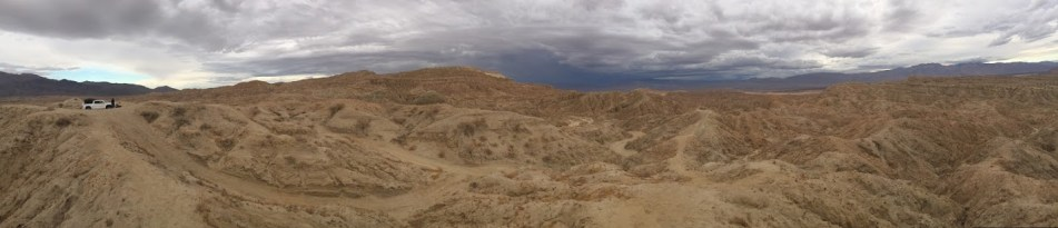 No civilization in sight. Solitude on sandy peaks.