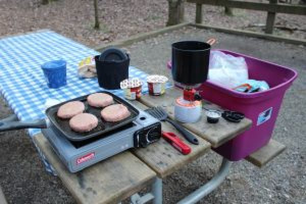 camp kitchen stove cooking meal hamburgers coleman