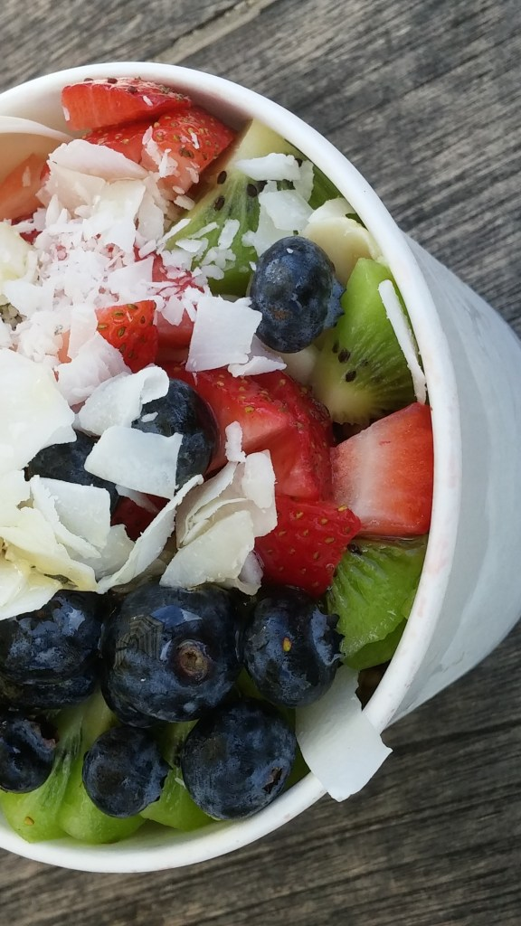 An acai bowl filled with fruits and coconut shavings from Hale'iwa Bowls. Posted on a travel guide that features the best things to do with kids on Oahu, Hawaii.