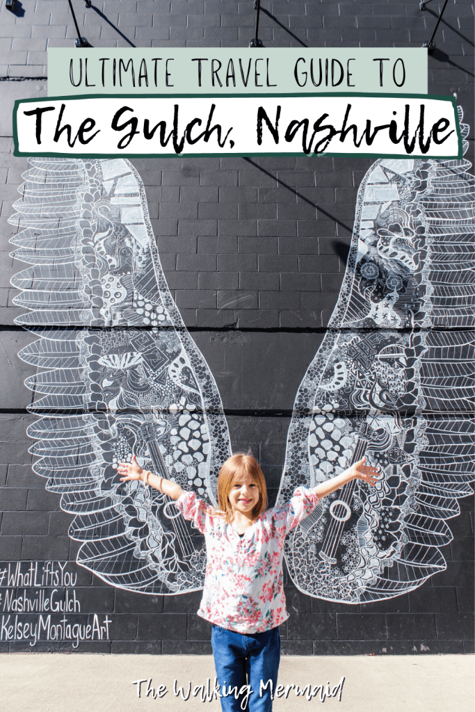 Ultimate Travel Guide To The Gulch in Nashville, Tennessee. Little girl posing at the mural What Lifts you at The Gulch.