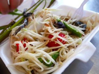 Green papaya and salted crab salad (som tum pu pla raa) at the market in Bangkok, Thailand
