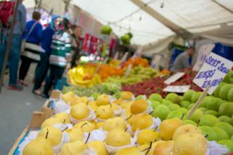 Fresh fruit creates a colorful mosaic at a public market.
