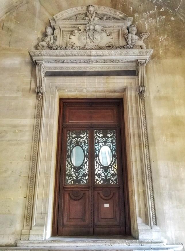 door at Louvre museum Paris france