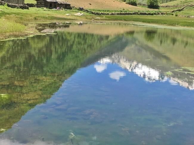 Lake reflection at Sangla Kanda Himachal Pradesh India